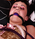 Helplessly bound with ropes and ball-gagged