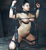 Busty brunette cuffed, gagged, pegged and caned