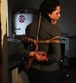 Steffi dangling on rope, tightly ball-gagged, drooling