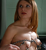 Slavegirl roped, clamped and waxed