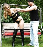 Blondie roped, hooded, tape-gagged and hogtied