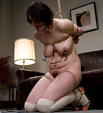 Pretty brunette roped, clamped, ball-gagged and vibed