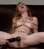 Redhead gets tightly roped for her helpless orgasm