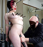 Tied up in the exercise room, pussy penetrated and vibrated