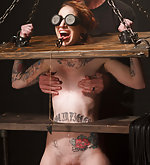 Redhead model gets her first device bondage experience