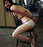 Uncomfortably tied to a chair and extreme tight cleave-gagged