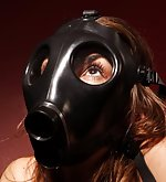 Brunette in boots and gasmask