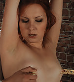 Redhead roped, pegged, whipped, and fucked