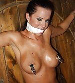 Bound spread eagle, cleave-gagged, nipple-clamped