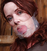 Redhead gets tightly roped, gagged and used