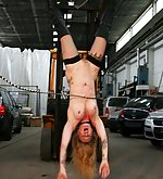 Hanged head down and lashed under a forklift