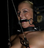 Sara tied to a torture chair, impaled and vibrated