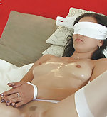 Ally roped on the bed, blindfolded and licked