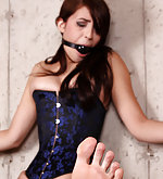 Tied to the wooden frame, ball-gagged, vibed