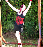 Captured redhead gets roped outdoors
