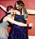 Two redheads bound together and gagged