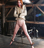 Redhead gets put in straitjacked, suspended and dildoed