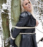 Blonde slut tied to the tree and and ball-gagged