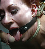 Redhead gets roped, pussy clamped and used