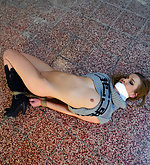 Anouk immobilized, hogtied, mouth-stuffed, tape-gagged