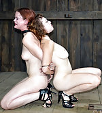 Two naked girls cuffed together