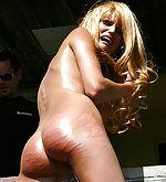Extreme severe branch whipping of her oiled ass