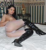 White pantyhose and high heeled leather boots