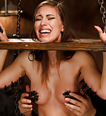 Bound in a stressful position for pain and pleasure