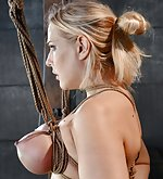 Busty blond tortured and teased in tight rope bondage