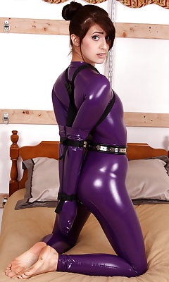 Latex catsuit, armbinder, chastity belt, ball-gag