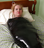 Mummified, wrap-gagged and chained