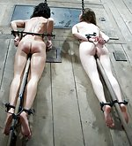 Two pretty girls in hard metal bondage