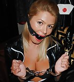 Whore wife poses in latex, cuffs and ball-gag