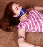 Strapped to the floor, gagged and vibed