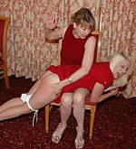 Blonde over-the-knee spanked by strict woman