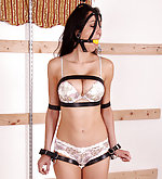 Brunette gets bound with leather straps and ball-gagged