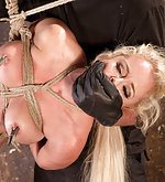 Sexy blonde slut in her first extreme bondage