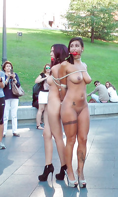 Two gorgeous models are tied up and publicly humiliated