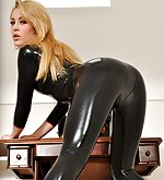 Cute blonde poses in shiny black latex