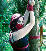 Redhead roped and tape-gagged outdoors
