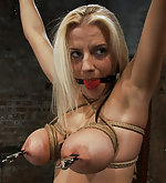 Cute busty blonde in her first ever hardcore bondage shoot